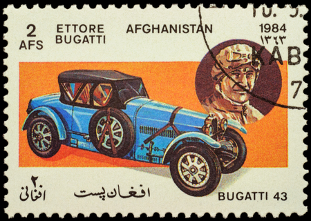 founder: MOSCOW, RUSSIA - FEBRUARY 05, 2016: A stamp printed in Afghanistan shows car Bugatti Type 43 (1927) and portrait of Ettore Bugatti - company founder, series Classic Automobiles, circa 1984