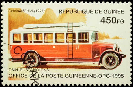 omnibus: MOSCOW, RUSSIA - FEBRUARY 10, 2016: A stamp printed in Guinee shows old omnibus MAN (1906), series Veteran Omnibuses, circa 1995