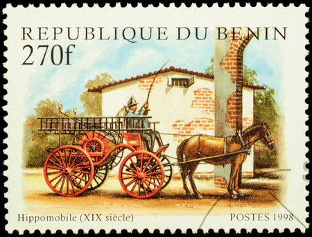 post stamp: MOSCOW, RUSSIA - FEBRUARY 12, 2016: A stamp printed in Benin shows vintage horse-drawn firefighting transport, series Fire Engines, circa 1998