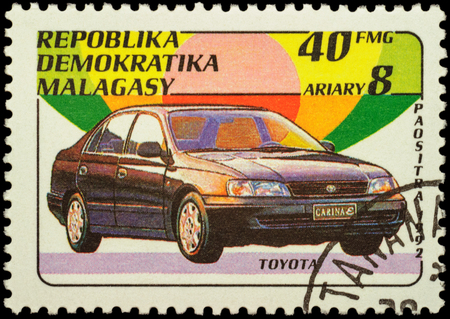 post stamp: MOSCOW, RUSSIA - FEBRUARY 14, 2016: A stamp printed in Malagasy shows car Toyota Carina, series Cars, circa 1992