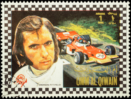 MOSCOW, RUSSIA - FEBRUARY 14, 2016: A stamp printed in Umm al-Quwain shows Emerson Fittipaldi - Brazilian racing driver in Formula One, series, circa 1972 Editorial