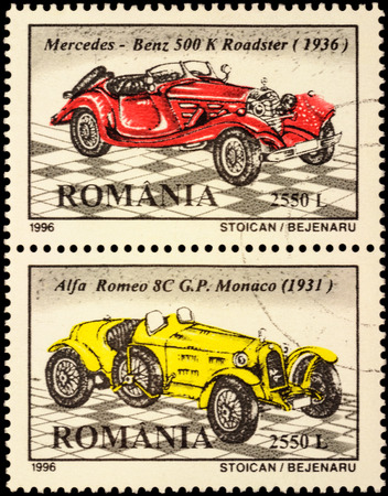 alfa: MOSCOW, RUSSIA - FEBRUARY 15, 2016: A set of stamps printed in Romania shows 2 old cars - Mercedes-Benz 500K Roadster (1936), Alfa Romeo 8C (1931), series Classic Cars, circa 1996