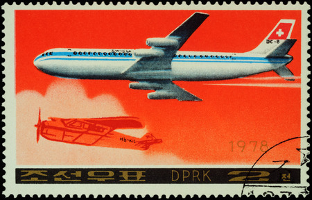 passenger aircraft: MOSCOW, RUSSIA - APRIL 10, 2016: A stamp printed in DPRK (North Korea) shows American passenger aircraft Douglas DC-8-53 and old airplane, series Airplanes, circa 1978
