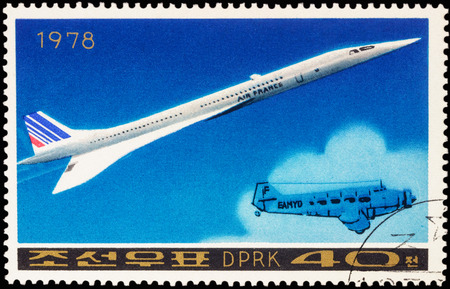 supersonic: MOSCOW, RUSSIA - APRIL 09, 2016: A stamp printed in DPRK (North Korea) shows Anglo-French supersonic passenger aircraft Concorde and old airplane, series Airplanes, circa 1978 Editorial