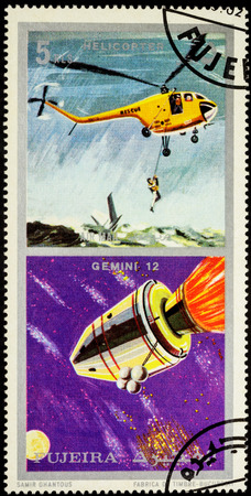 MOSCOW, RUSSIA - APRIL 07, 2016: A stamp printed in Fujeira shows spacecraft Gemini 12 and helicopter, series Air and Space Vehicles, circa 1971