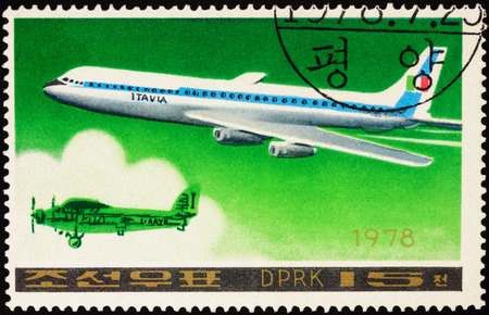 passenger aircraft: MOSCOW, RUSSIA - APRIL 10, 2016: A stamp printed in DPRK (North Korea) shows American passenger aircraft Douglas DC-8-63 and old airplane, series Airplanes, circa 1978