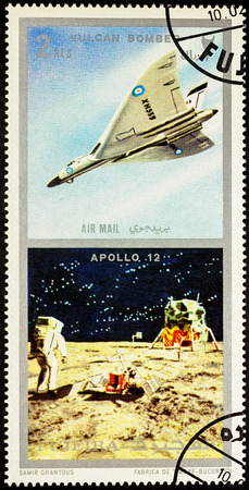 MOSCOW, RUSSIA - APRIL 09, 2016: A stamp printed in Fujeira shows spacecraft Apollo 12 on the Moon and Vulcan bomber, series Air and Space Vehicles, circa 1971