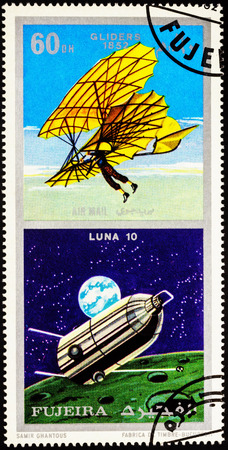 A stamp printed in Fujeira shows spacecraft Luna 10 and ancient glider (1852), series Air and Space Vehicles, circa 1971