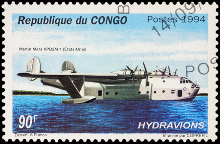 long range: MOSCOW, RUSSIA - APRIL 12, 2016: A stamp printed in Congo shows American long range ocean patrol flying boat Martin Mars XPB2M-1, series Seaplanes, circa 1994