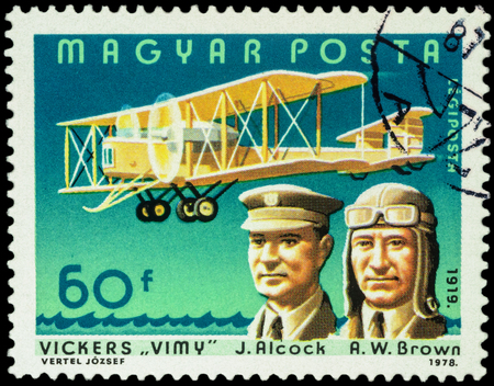 aviators: MOSCOW, RUSSIA - APRIL 12, 2016: A stamp printed in Hungary shows aviators John Alcock and Arthur Whitten Brown with airplane Vickers Vimy, series Pilots and Aircrafts, circa 1978