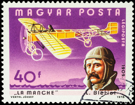 manche: MOSCOW, RUSSIA - APRIL 12, 2016: A stamp printed in Hungary shows French aviator Louis Bleriot and his plane over the Strait of La Manche, series Pilots and Aircrafts, circa 1978