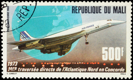 concorde: MOSCOW, RUSSIA - APRIL 12, 2016: A stamp printed in Mali shows supersonic passenger aircraft Concorde, devoted to the 15th Anniversary of First North Atlantic Crossing by Concorde, circa 1988