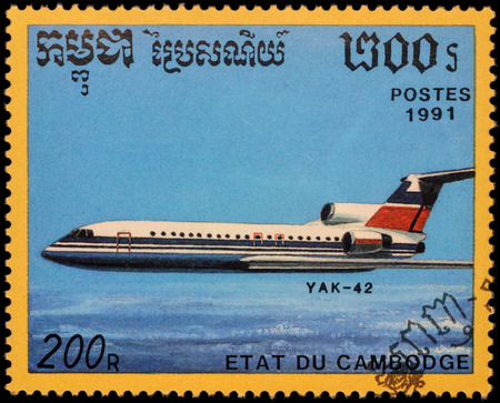 passenger aircraft: MOSCOW, RUSSIA - APRIL 19, 2016: A stamp printed in Cambodia shows russian passenger aircraft Yak-42, series Airplanes, circa 1991
