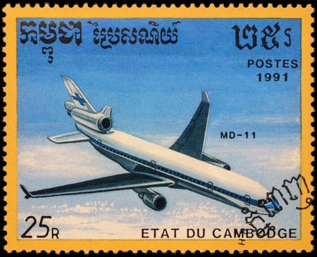 passenger aircraft: MOSCOW, RUSSIA - APRIL 19, 2016: A stamp printed in Cambodia shows passenger aircraft McDonnell Douglas MD-11, series Airplanes, circa 1991 Editorial