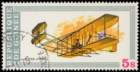 MOSCOW, RUSSIA - APRIL 17, 2016: A stamp printed in Guinea shows flight of the first airplane of Wright brothers (1903), series