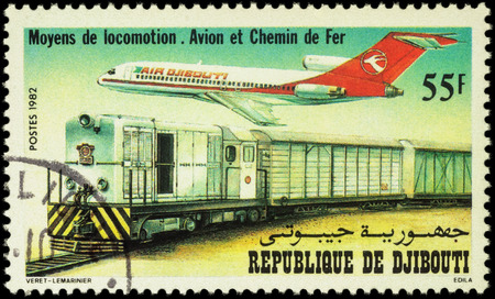 MOSCOW, RUSSIA - APRIL 21, 2016: A stamp printed in Djibouti shows Boeing 727-100 Airliner and Alsthom Series BB 500 Diesel Locomotive and Train, series