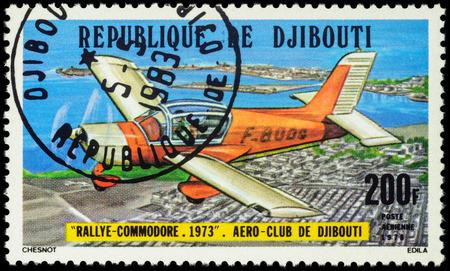 light aircraft: MOSCOW, RUSSIA - APRIL 21, 2016: A stamp printed in Djibouti shows French light aircraft Morane Saulnier Rallye Commodore, series Djibouti Aero Club, circa 1978