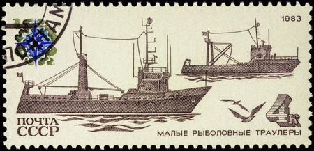 fishing fleet: MOSCOW, RUSSIA - APRIL 26, 2016: A stamp printed in USSR (Russia) shows coastal trawlers, series Fishing Vessels, circa 1983