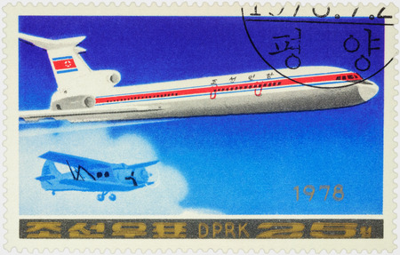 passenger aircraft: MOSCOW, RUSSIA - APRIL 10, 2016: A stamp printed in DPRK (North Korea) shows Soviet passenger aircraft Tupolev Tu-154 and old airplane, series Airplanes, circa 1978
