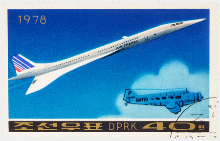 passenger aircraft: MOSCOW, RUSSIA - APRIL 09, 2016: A stamp printed in DPRK (North Korea) shows Anglo-French supersonic passenger aircraft Concorde and old airplane, series Airplanes, circa 1978 Editorial