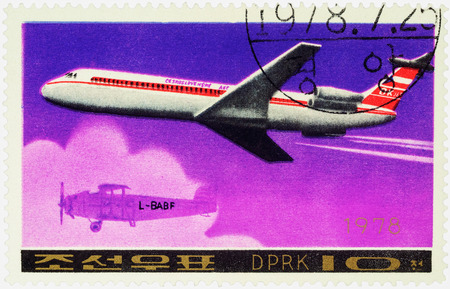 passenger aircraft: MOSCOW, RUSSIA - APRIL 10, 2016: A stamp printed in DPRK (North Korea) shows soviet passenger aircraft Ilyushin Il-62M and old airplane, series Airplanes, circa 1978