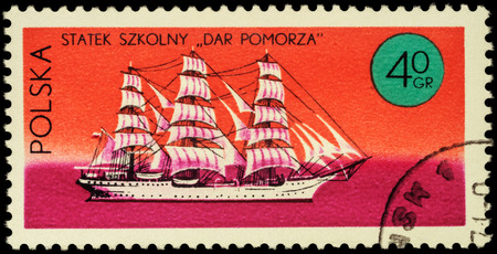 MOSCOW, RUSSIA - APRIL 25, 2016: A stamp printed in Poland shows three-masted sailing ship Dar Pomorza, series Ships under the Polish Flag, circa 1971