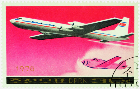 passenger aircraft: MOSCOW, RUSSIA - APRIL 10, 2016: A stamp printed in DPRK (North Korea) shows soviet passenger aircraft Ilyushin Il-18 and old airplane, series Airplanes, circa 1978 Editorial