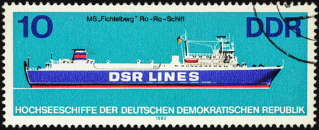 east germany: MOSCOW, RUSSIA - APRIL 27, 2016: A stamp printed in GDR (East Germany) shows Ro-Ro ship Fichtelberg, series Ocean-going ships, circa 1982 Editorial