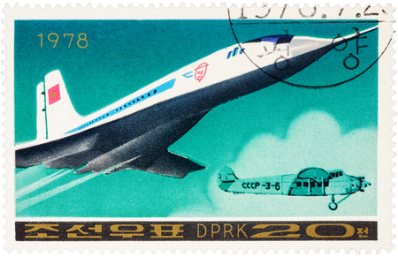 supersonic: MOSCOW, RUSSIA - APRIL 09, 2016: A stamp printed in DPRK (North Korea) shows Russian supersonic passenger aircraft Tu 144 and old airplane, series Airplanes, circa 1978