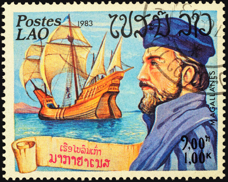 descubridor: MOSCOW, RUSSIA - MAY 06, 2016: A stamp printed in Laos shows Ferdinand Magellan and his ship Victoria, series Explorers and their Ships, circa 1983 Editorial