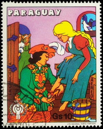 cinderella shoes: MOSCOW, RUSSIA - MAY 11, 2016: A stamp printed in Paraguay shows Cinderella and Prince - scene from a fairy tale, series International Year of the Child - Grimms Fairy Tale Cinderella, circa 1979