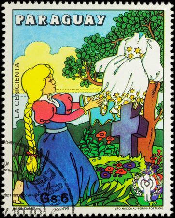 legends folklore: MOSCOW, RUSSIA - MAY 11, 2016: A stamp printed in Paraguay shows Cinderella with new dress, scene from fairy tale, series International Year of the Child - Grimms Fairy Tale Cinderella, circa 1979 Editorial