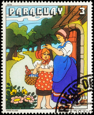 red stamp: MOSCOW, RUSSIA - MAY 12, 2016: A stamp printed in Paraguay shows scene from a fairy tale Little Red Riding Hood, series International Year of the Child - Grimms Fairy Tales, circa 1979