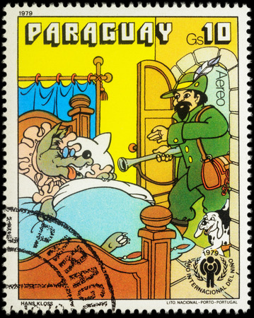 legends folklore: MOSCOW, RUSSIA - MAY 12, 2016: A stamp printed in Paraguay shows scene from a fairy tale Little Red Riding Hood, series International Year of the Child - Grimms Fairy Tales, circa 1979