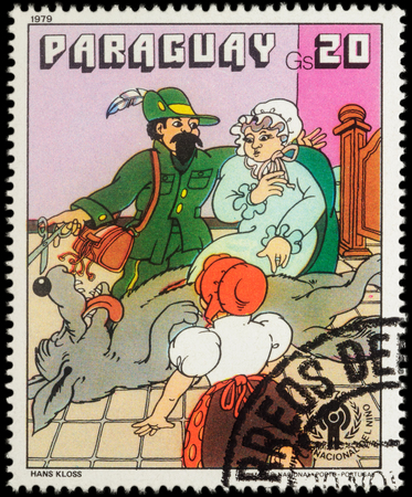 little red riding hood: MOSCOW, RUSSIA - MAY 12, 2016: A stamp printed in Paraguay shows scene from a fairy tale Little Red Riding Hood, series International Year of the Child - Grimms Fairy Tales, circa 1979
