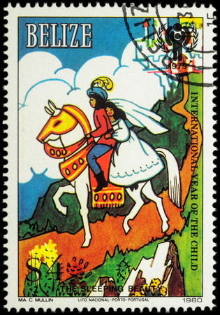 legends folklore: MOSCOW, RUSSIA - MAY 14, 2016: A stamp printed in Belize shows Prince and princess at horse - scene from a fairy tale Sleeping Beauty, series International Year of the Child, circa 1980