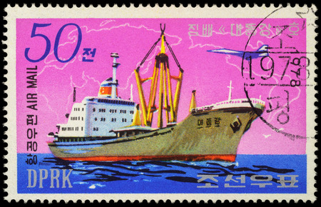 freighter: MOSCOW, RUSSIA - MAY 17, 2016: A stamp printed in DPRK (North Korea) shows image of North Korean freighter Taedonggang, series Ships, circa 1978