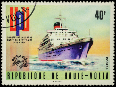 upu: MOSCOW, RUSSIA - MAY 17, 2016: A stamp printed in Upper Volta (Burkina Faso) shows old cruise ship, series The 100th Anniversary of UPU Congress in Lausanne circa 1974 Editorial