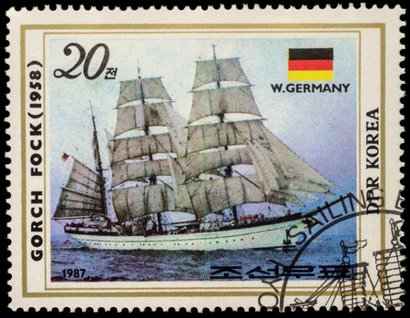 fock: MOSCOW, RUSSIA - MAY 17, 2016: A stamp printed in DPRK (North Korea) shows image of Gorch Fock II, a tall ship of the German Navy (1958) and flag of Germany, series Sailing Ships, circa 1987