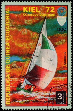 yachtsman: MOSCOW, RUSSIA - APRIL 27, 2016: A stamp printed in Equatorial Guinea shows yachting, the race in Soling class, series Olympic Games - Munich, Germany, circa 1972