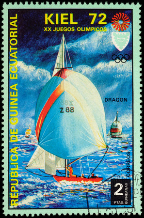 yachtsman: MOSCOW, RUSSIA - MAY 17, 2016: A stamp printed in Equatorial Guinea shows yachting, the race in Dragon class, series Olympic Games - Munich, Germany, circa 1972 Editorial