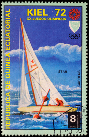 yachtsman: MOSCOW, RUSSIA - MAY 17, 2016: A stamp printed in Equatorial Guinea shows yachting, the race in Star class, series Olympic Games - Munich, Germany, circa 1972 Editorial
