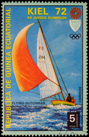 yachtsman: MOSCOW, RUSSIA - MAY 17, 2016: A stamp printed in Equatorial Guinea shows yachting, the race in Flying Dutchman class, series Olympic Games - Munich, Germany, circa 1972