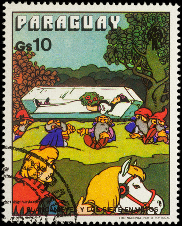 seven dwarfs: MOSCOW, RUSSIA - MAY 21, 2016: A stamp printed in Paraguay shows Snow White in crystal coffin, series International Year of Child - Grimms Fairy Tale Snow White and the Seven Dwarfs, circa 1978 Editorial