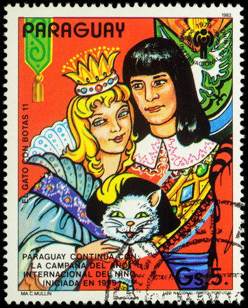 puss: MOSCOW, RUSSIA - MAY 21, 2016: A stamp printed in Paraguay shows princess, millers son and cat, series International Year of the Child - Fairytale Puss in Boots, circa 1982