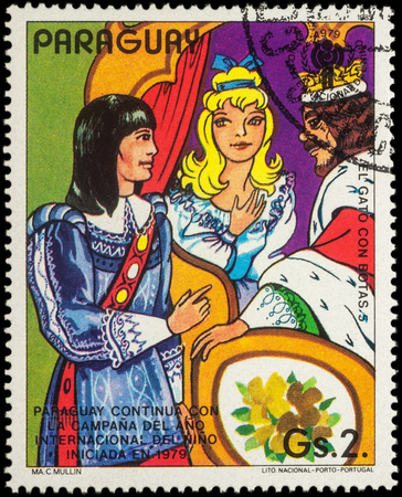 puss: MOSCOW, RUSSIA - MAY 21, 2016: A stamp printed in Paraguay shows conversation between king, princess and millers son, series International Year of the Child -  Fairytale Puss in Boots, circa 1982