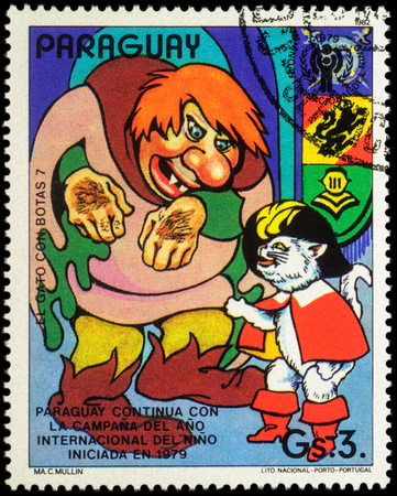 puss: MOSCOW, RUSSIA - MAY 21, 2016: A stamp printed in Paraguay shows Puss in Boots and cannibal, series International Year of the Child - Fairytale Puss in Boots, circa 1982