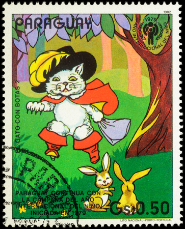 puss: MOSCOW, RUSSIA - MAY 21, 2016: A stamp printed in Paraguay shows Puss in Boots and hares in the forest, series International Year of the Child - Fairytale Puss in Boots, circa 1982