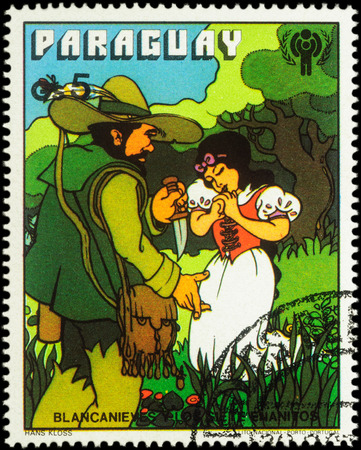 seven dwarfs: MOSCOW, RUSSIA - MAY 21, 2016: A stamp printed in Paraguay shows Hunter and Snow White, series International Year of the Child - Grimms Fairy Tale Snow White and the Seven Dwarfs, circa 1978