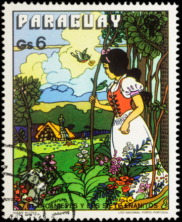 seven dwarfs: MOSCOW, RUSSIA - MAY 21, 2016: A stamp printed in Paraguay shows Snow White in forest, series International Year of the Child - Grimms Fairy Tale Snow White and the Seven Dwarfs, circa 1978